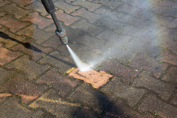 Outdoor floor clean driveway with pressure water jet