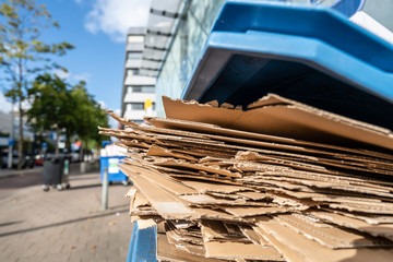 Flattened cardboard boxes waiting to be collected
