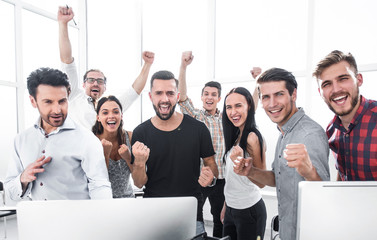 happy professional business team standing in modern office