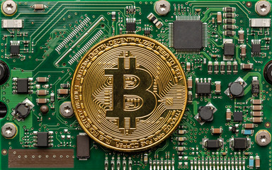 Physical bitcoin on top of a circuit board.