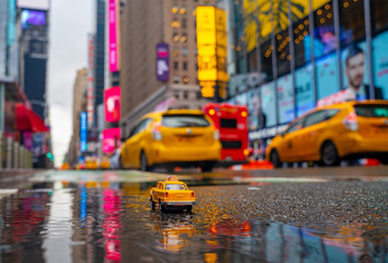 Vintage old Taxi toy in New York City most popular places. Classic Yellow Cab in Manhattan and...