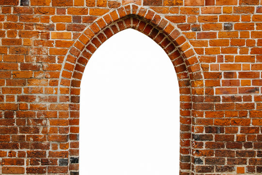 Portal door arch way window frame filled with white in the center of ancient red orange brick wall with as surface texture background.