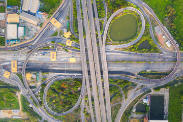 Aerial View Above of Busy Highway Road Junctions at day. The Intersecting Freeway Road Overpass The...