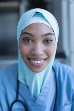 Portrait of smiling female doctor wearing hijab