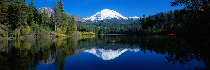 Amazing Nature Photography From Oregon with Mountains, Lake, Trees. Beautiful Reflection in Clear Water. Panoramic View of Landscape and Dramatic Blue Sky.