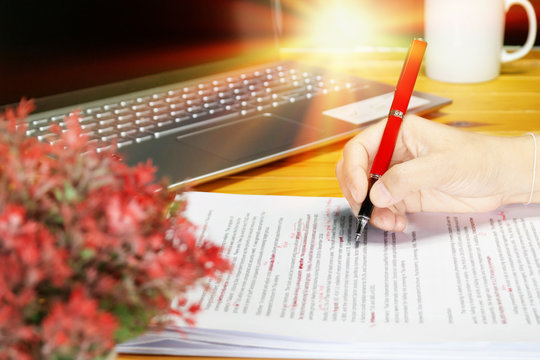 proofreading paper on table