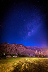 Starry night in mountains in northern Argentina. Clear sky with milky way at Cerro de los Siete Colores Hiking Trail,, Purmamarca, Argentina. The Andes, beginning of the Andean plateau. Quebrada de Hu