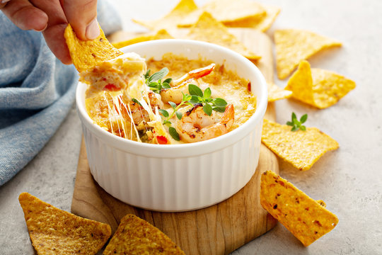 Spicy seafood dip in a ramekin with corn chips