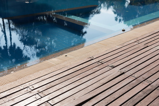 Damage Wooden deck on side of swimming pool