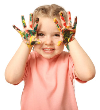 Funny little girl with hands in paint on white background