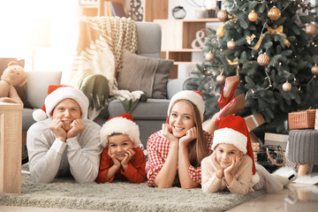 Happy family at home on Christmas eve