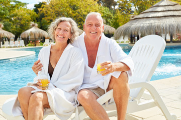 Senior couple in spa vacation at the pool