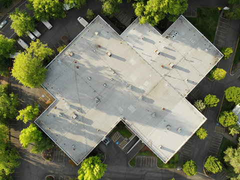 Photo of the roof of a large house and the landscape top view, texture for design
