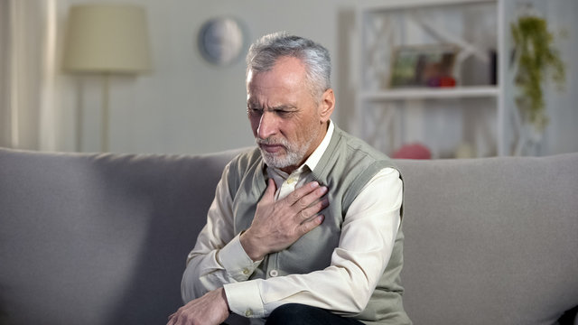 Pensioner suffering chest pain, heart attack, problems with breathing, asthma