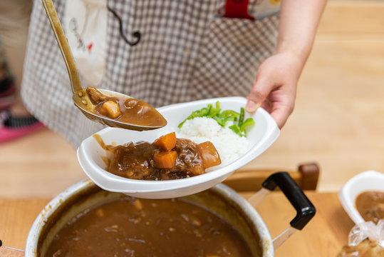 preschool staff serving curry rice in japan