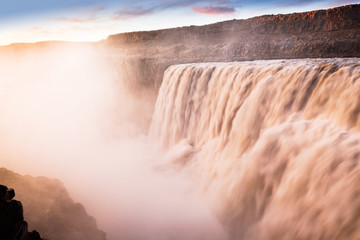 Great Waterfall Dettifoss in Vatnajokull National Park in Northeast Iceland. Amazing scene of natural wonder  - waterfall on white nights in Iceland on summer. Twilight all night long. Iconic landmark