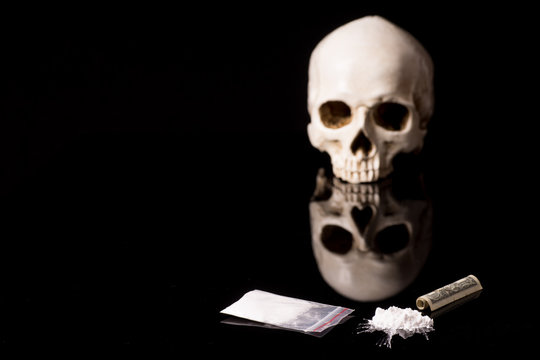 cocaine or other illegal drugs lying on a glossy background
