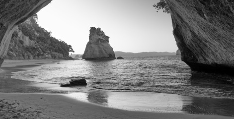 Cathedral Cove framed by arch on the beach, Coromandel, New Zealand