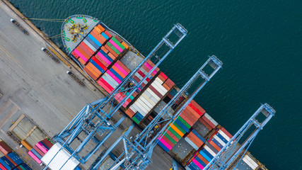 Aerial view cargo ship terminal, Unloading crane of cargo ship terminal, Aerial view industrial port with containers and container ship. Fototapete