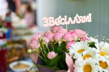 Wedding bouquet of roses with the Ukrainian inscription made of wood