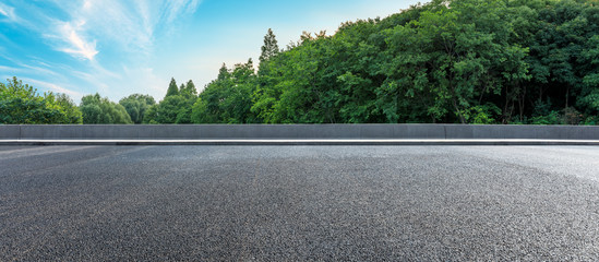 Asphalt highway and green forest with beautiful clouds landscape Fotomurales