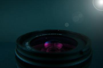 SLR camera lens in the spotlight Wall mural