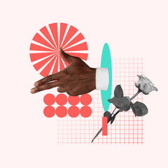 Taking a target. Male's hand with rose on pink background. Negative space to insert your text....