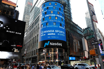 Wanda Sports Group logo, the sport-related business unit of Chinese conglomerate Wanda Group, is seen displayed at the Nasdaq Market Site ahead of IPO in New York