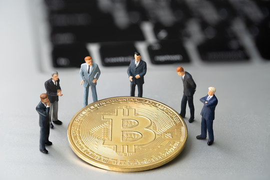 Bitcoin (BTC) Coin and businessmans on notebook. digital cyber safety or security encryption. Manage bitcoin price schedule concept. Money laundering bitcoin concept. Market Manipulation.