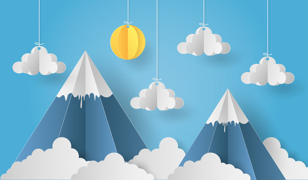 Paper art of origami mobile paper sun and cloud with mountain on blue sky backgrond