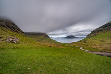 Typical landscape of Faroe islands with cloudy sky