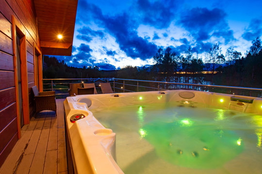 Pool with hydromassage with lighting in the cottage. spa-zone. Water treatments for health and relaxation. Rest in a cottage with a bath. Spa-procedures in the fresh
