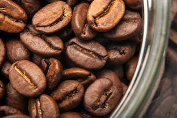 Wall Mural - roasted coffee beans in a glass jar macro
