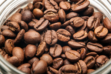 Wall Mural - roasted coffee beans in a glass jar