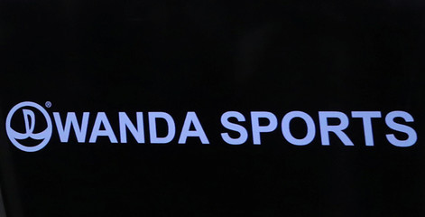 The logo for the Wanda Sports Group, the sport-related business unit of Chinese conglomerate Wanda Group, is seen at the Nasdaq Market site in New York