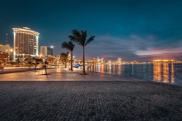 Picture of city buildings and ocean at night, Luanda, Angola