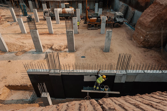 High angle view of a man constructing wall