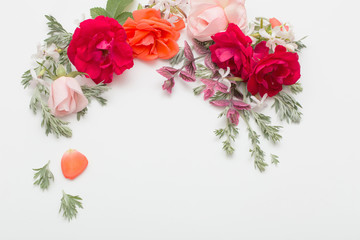 Fotobehang Bloemen rose flowers and leaves on white background