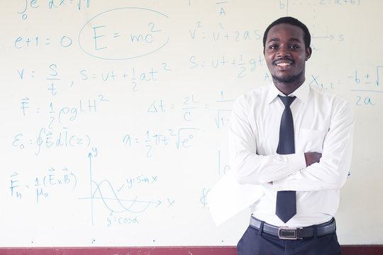 African teacher teaching  science in the classroom.