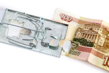 Mousetrap is on  banknote with hole