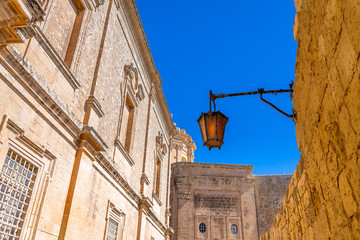 Typical Windows and Lamps in Mdina. Exposure done in the beautiful medieval town of Mdina, Malta.