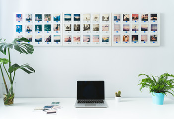 Desktop with laptop and instant photos