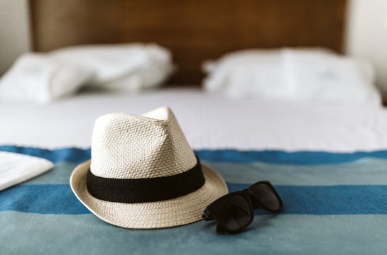 Close up on white straw hat and retro sunglasses
