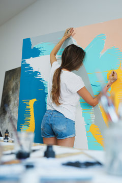 Young woman painting.
