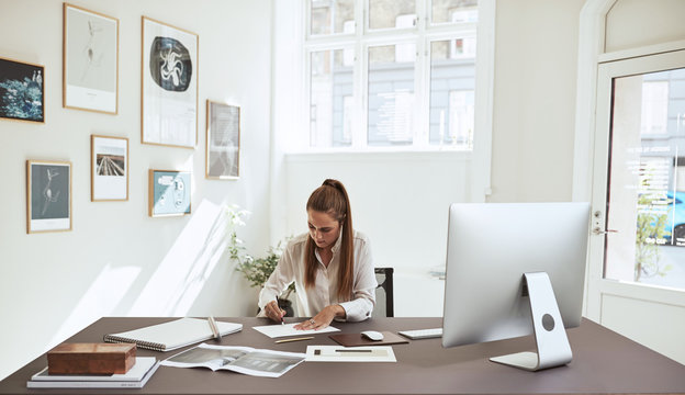 Young female architect working on a design in her office