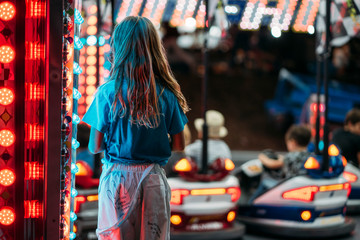 Girl standing at electric cars