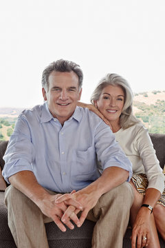 Portrait of mature couple at home