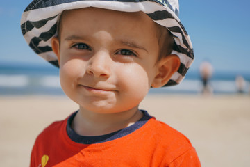 Portrait of Little kid playing at the seashore