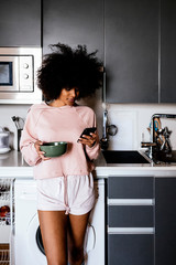 Beautiful afro woman using the mobile phone