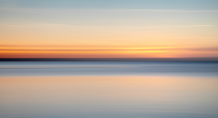 Blurred sunset over the sea.